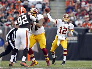 Washington Redskins quarterback Kirk Cousins passes against the Cleveland Browns in the second quarter of an NFL football game in Cleveland.