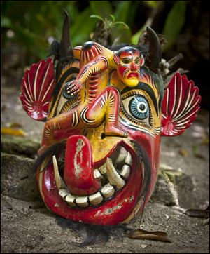 An antique Mayan Mask on display at the Maya Palms Resort in Mahahual, Mexico.
