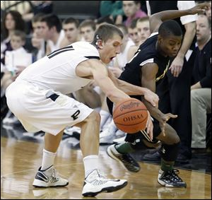 Perrysburg's Bryant Byrd, left, and Start's Dion Ivery scramble for a loose ball on Saturday night in Perrysburg. Start used a decisive 13-1 run in the fourth quarter to win on the road.