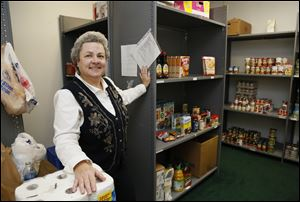 Case worker Mary Glover-Booher says the food pantry of the center in Temperance can use donations any time of year.