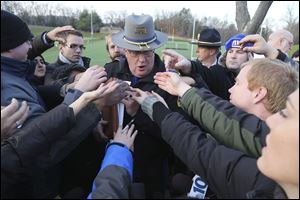 Lt. J. Paul Vance of the Connecticut State Police is surrounded by reporters as he hands out the list of victims of the shooting at the Sandy Hook Elementary School,  Saturday, in Newtown, Conn.