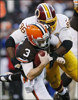 The Redskins' Barry Cofield (96) sacks the Browns' Brandon Weeden in the fourth quarter.