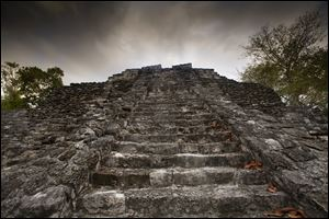 Looking up a temple pyramid at the Mayan ruins at Chacchoben, Mexico.