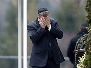 A mourner arrives at a funeral service in Fairfield, Conn., for Noah Pozner, 6, one of two funerals held Monday for school shooting victims.