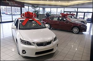 Cars at the Jim White Lexus dealership on Central Avenue sport the bows that the automaker supplies at Christmas time.