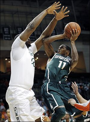 Michigan State's Keith Appling shoots over Miami's Reggie Johnson. The junior leads the Spartans at 15.5 points per game.