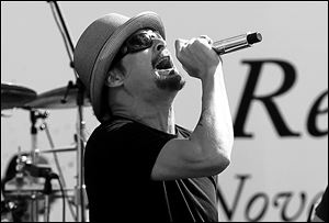 Kid Rock performs a concert before the NASCAR Sprint Cup Series championship race at Homestead-Miami Speedway in Homestead, Fla.,