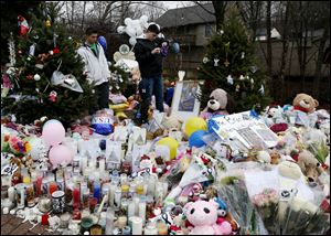 One of several makeshift memorials in the Sandy Hook Village of Newtown, Conn., as the town mourns victims killed in a school shooting.