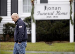 A mourner leaves a funeral service today for Sandy Hook Elementary School shooting victim, Jack Pinto, 6, in Newtown, Conn.