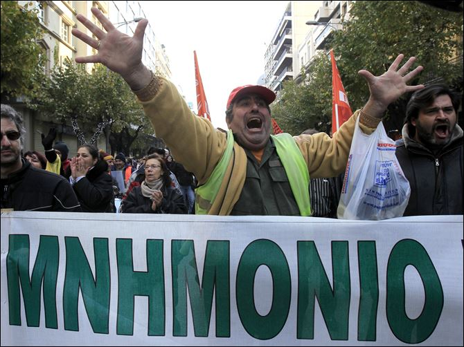 Greece Financial Crisis  Striking Greek municipal employees chant slogans during a protest outside at the northern port city of Thessaloniki, Greece as a banner reads in Greek