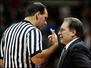 Michigan State head coach Tom Izzo argues a call with an official.