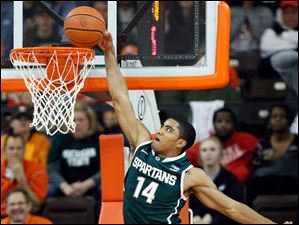 Michigan State guard Gary Harris dunks the ball.