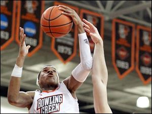 Bowling Green State University forward Richaun Holmes pulls in a rebound  against Michigan State forward Alex Gauna.