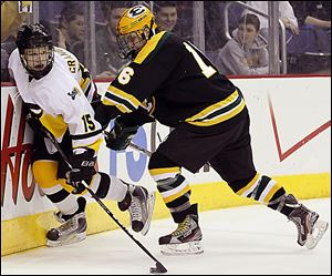 Northview's Drew Crandall, left, moves the puck against Lakewood St. Edward's Matt Geib in the state final last season. Crandall had 15 goals and 19 assists last year.