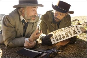 "Christoph Waltz as Schultz, left, and Jamie Foxx as Django in the film, ""Django Unchained,"" directed by Quentin Tarantino."