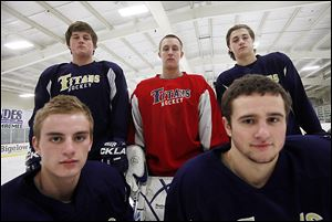 St. John's is the preseason favorite to win the Northwest Hockey Conference Red Division with (front, from left) Collin Suter, Austin Kelly, and (back) Ryan Rapp, Mike Barrett and Ian Rapp. The Titans are off to a 6-0-0 start in the league this season.