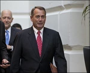 Speaker of the House John Boehner arrives for a closed-door meeting with House Republicans as he negotiates with President Obama to avert the fiscal cliff.