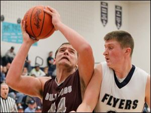 Rossford's Nate Childress puts up two over Flyers' junior Jayce Vancena.