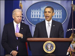 President Obama stands with Vice President Biden as he makes a statement in the Brady Press Briefing Room at the White House about policies he will pursue following the Newtown, Conn., school shootings.