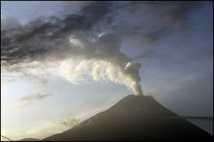 The Tungurahua volcano emits an an ash-filled plume as seen from Huambalo, Ecuador, Monday.