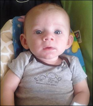 Toledo Police said Avery Glynn Bacon, 6 months old, died Tuesday night about 11 p.m.