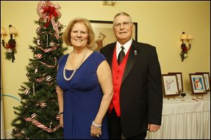 Sally and John Welch, past president of the Perrysburg Rotary Club, pose for a picture during the Perrysburg Rotary Holiday Party at Carranor Hunt and Polo Club in Perrysburg.