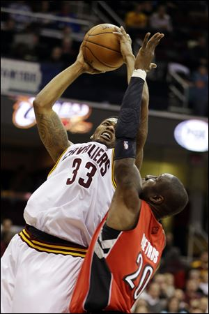 The Cavs' Alonzo Gee shoots over the Raptors' Mickael Pietrus in the second quarter.