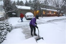 A-woman-and-her-husband-shovel-their
