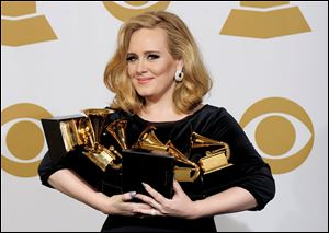 Singer Adele, at the 54th Annual Grammy Awards in February, won six awards, including album of the year. Her live performance that night marked her return from vocal surgery.