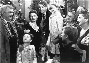 James Stewart, center, is reunited with his wife, Donna Reed, left, and children during the last scene of Frank Capra's 1946 classic,