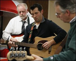Left to right Marty Mohler, Tom Puffenberger, and John Rozic. Jingle Balls plays only two shows per year; The Toledo Municipal Court's Holiday Lunchtime Potluck held at the Toledo Municipal Court Auditorium on December 21 at noon and a fundraising gig at Mickey Finn's Pub at 8 pm the same day.