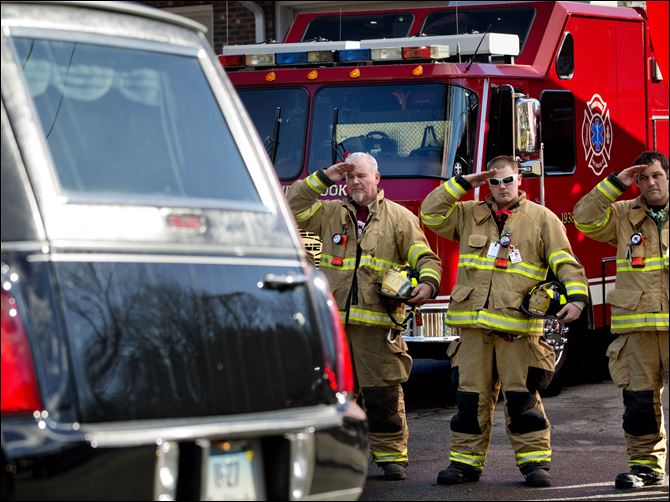 APTOPIX Connecticut School Shooting Firefighters salute as a hearse passes for the funeral procession to the burial of 7-year-old Sandy Hook Elementary School shooting victim Daniel Gerard Barden on Wednesday.