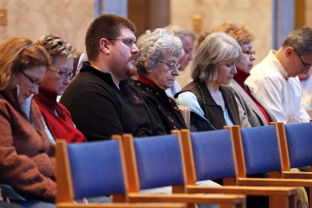 Participants-bow-their-heads-in-silence-during-a-memorial-service