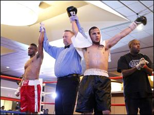 A majority draw is announced for Micah Branch, left, and Rafael Gramajo, after their fight.
