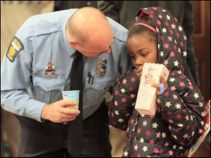 TPD officer Tyson Phalen, left, talks with Ny'Rena Barber, 7, at the union hall.