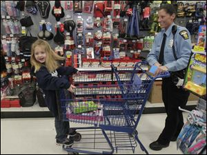 Kadence Fowler, 5, left, and TPD officer Tanya Fowler in the Toy Department.