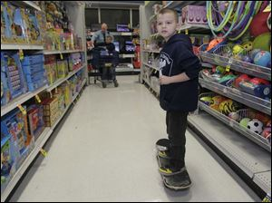 Kross Kerschner, 6, checks out a skateboard.