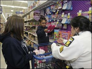 Child Services Bureau employee Rachelle Willen, left, Savannah Cole, 3, center, and TPD Sgt. Patricia Gomez.