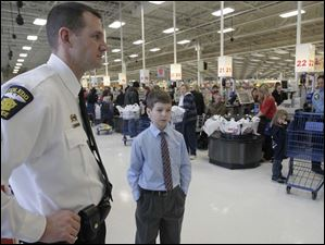 Sgt. Daniel Raab, left, with Nicholas Comment, 11,  who chose to dress up to look nice for the officers.