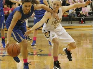 Anthony Wayne's guard Lauren Cardinal (2) attempts to maintain control of the ball as Perrysburg's guard Maddie Williams (12) goes in for the steal.
