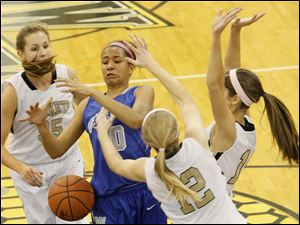 Anthony Wayne's guard Jasmine Bonivel (10) looses control of her rebound under Perrysburg pressure.