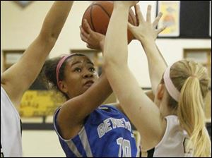 Anthony Wayne's guard Jasmine Bonivel (10) puts up two from inside the paint.