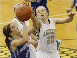 Perrysburg's forward Samantha Gremler (20) gets a hand on the ball as Anthony Wayne's guard Abby Allen (4) attempts to shoot.