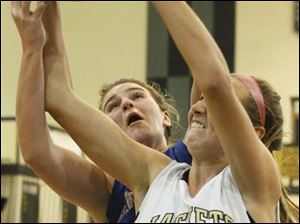 Perrysburg's forward Allex Brown (35) battles Anthony Wayne's forward Sara Zankl (40) for a rebound.
