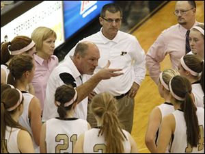Head Coach Todd Sims, center, talks to his team in a time out during.