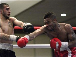 Rafael Gramajo, left, and Micah Branch, right, trade punches.