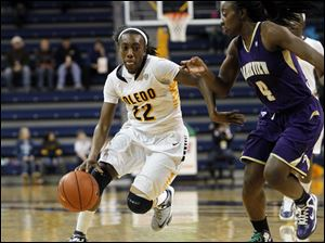 Andola Dortch, of the Toledo Rockets, drives the ball to the basket.