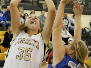 Perrysburg's forward Allex Brown (35) puts up two points over an Anthony Wayne defender.