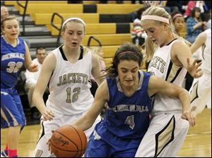 Anthony Wayne's guard Abby Allen (4) drives down the baseline to get around Perrysburg's guard Maddie Williams (12) and guard Abby Sattler (10).