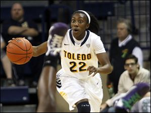Andola Dortch, of the Toledo Rockets, makes her way down the court as LaReahn Washington, of the Praire View A&M Panthers.